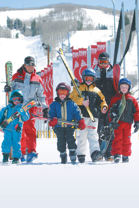 A group of young skiers hold their skis in Park City, Utah