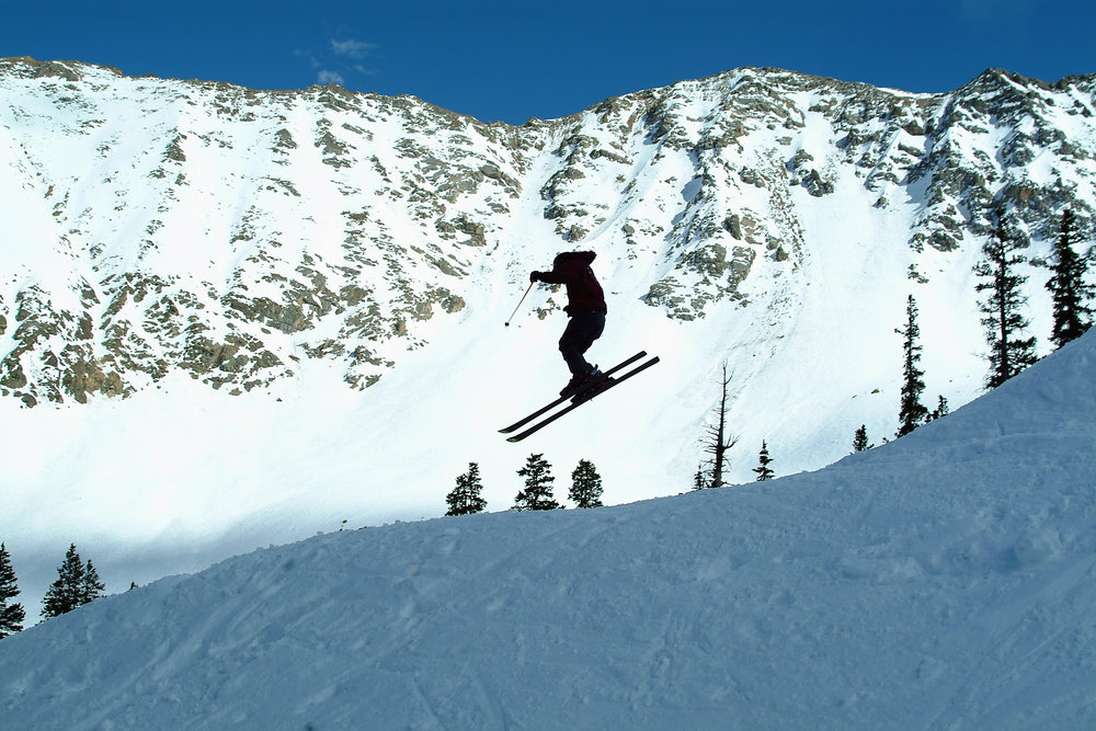 A skier catches air at Arapahoe Basin.