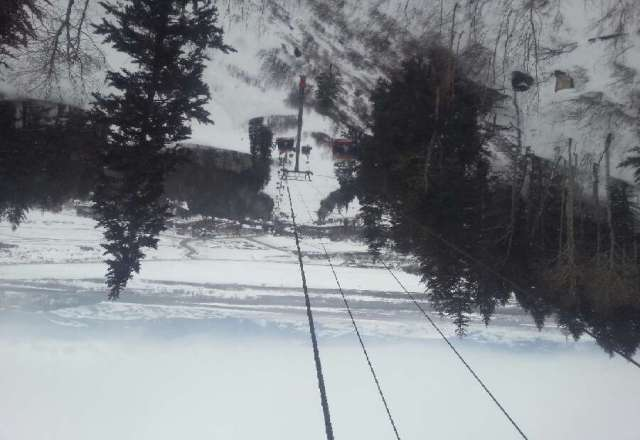 top of Bridget gondola has flurries but weather is fantastic
