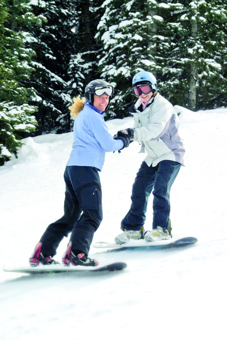 A snowboarder recieves lessons in Durango Mountain Resort, Colorado