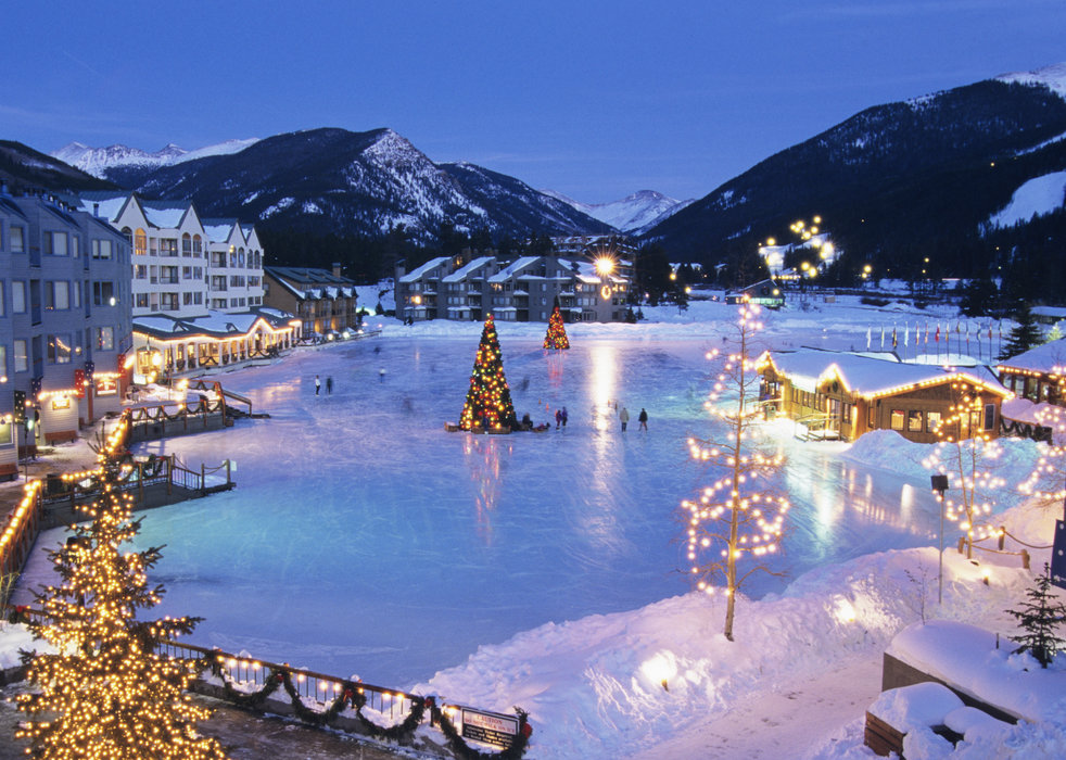 A view of a frozen lake and ice rink in Keystone, Colorado