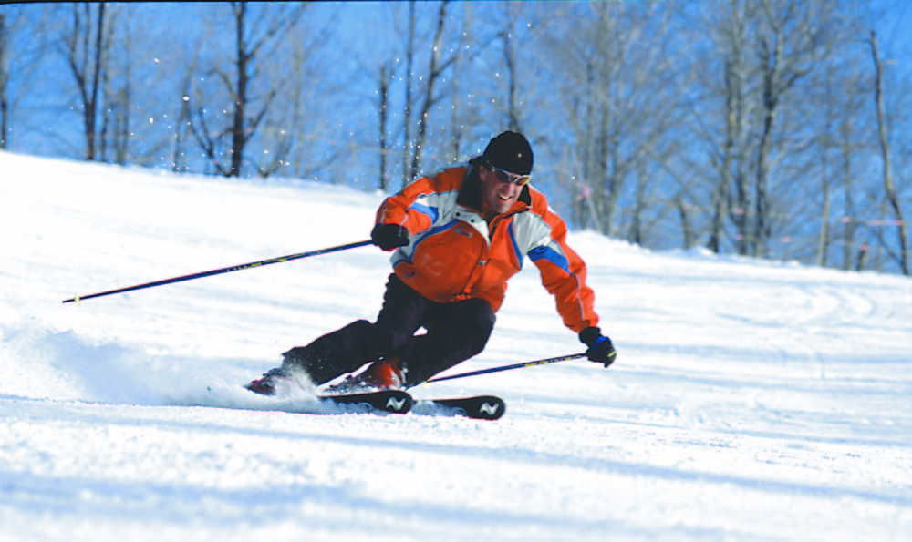 A skier makes a turn on the slopes of Crystal Mountain, Michigan