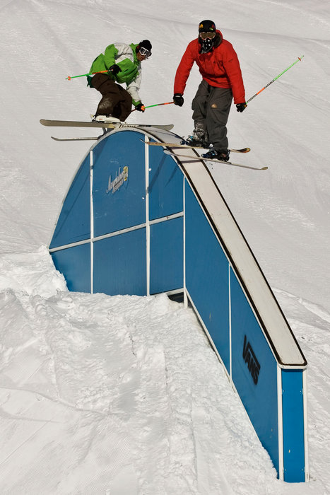 A pair of skiers at Mayrhofen's terrain park.