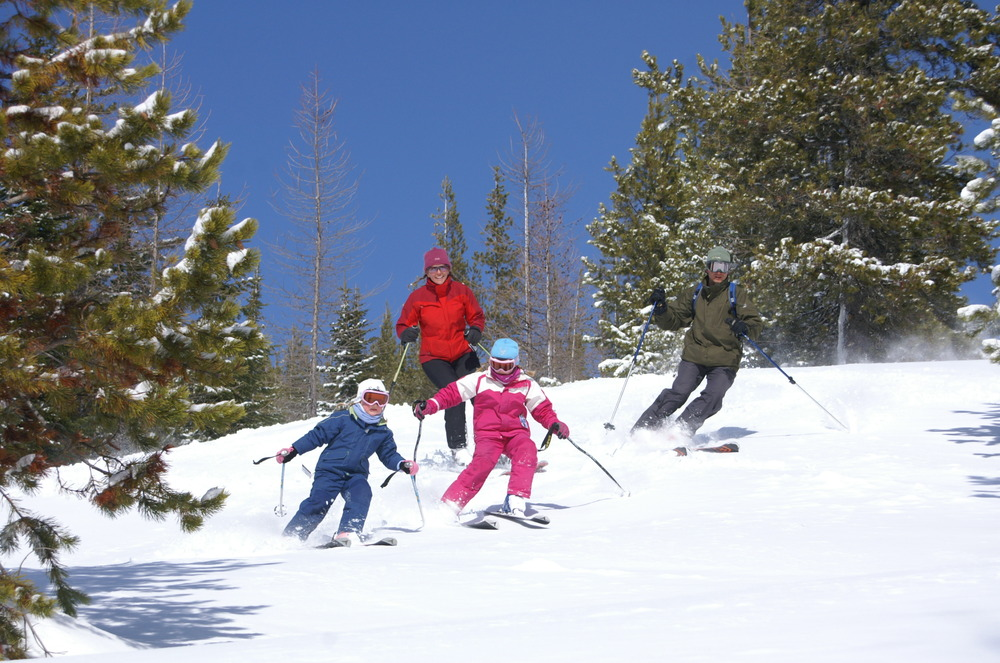 Family skiing in Schweitzer Mountain, Idaho. Photo courtesy of Schweitzer Mountain Resort.