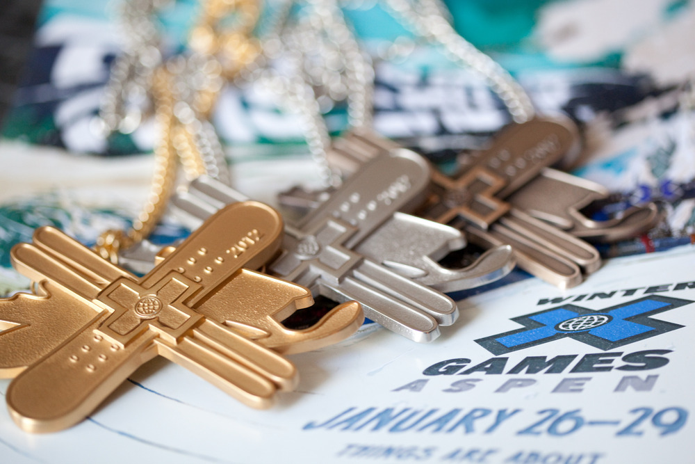 Gold, silver, and bronze X-Games medals. Photo by Sasha Coben
