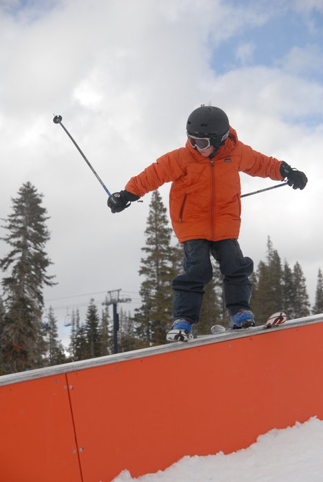A skier performs a trick in the terrain park at Sugar Bowl Ski Resort, California