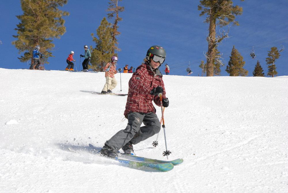 A telemark skier cruises down the mountain at Alpine Meadows, California