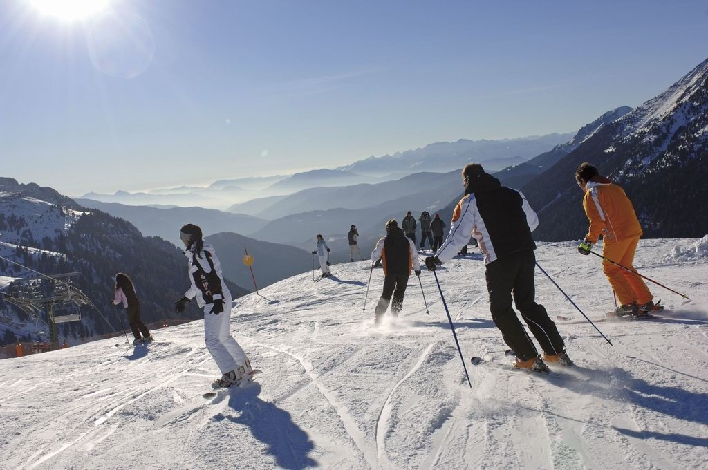 Skiers in the Val di Fiemme pistes