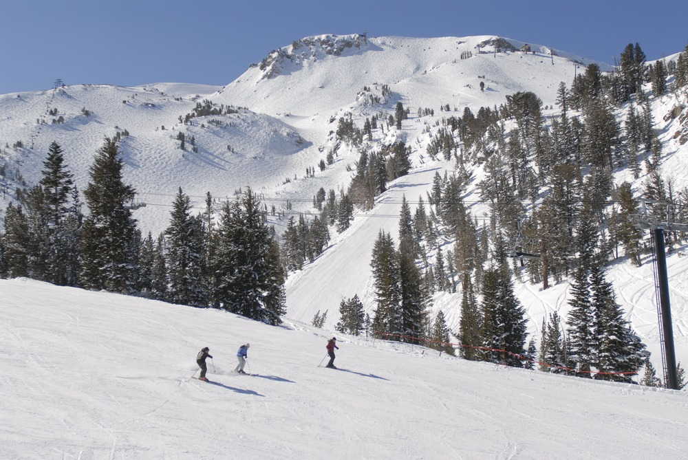 Skiers take in the view of Mammoth Mountain, California