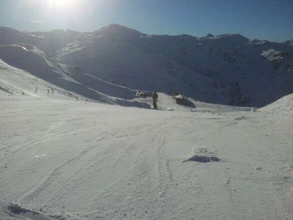 light powder on firm base. patchy down towards st martin but fab skiing in les menuires. some great red runs!