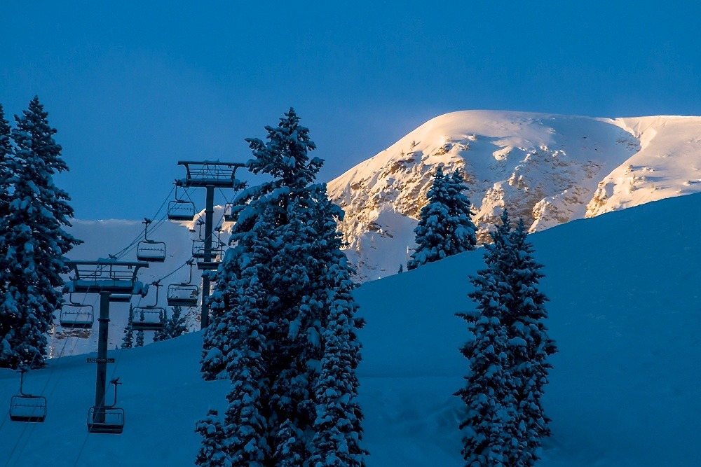 Morning Light on Baldy.  Alta is legendary not only for its massive snowfall but also for its beautiful light. Photo by Liam Doran