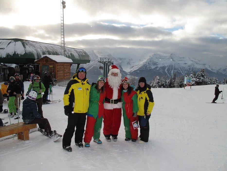 Santa posing with employees and elves at Lake Louise in Alberta, Canada - ©Lake Louise Resort
