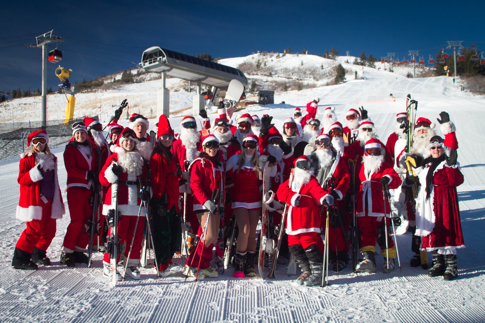 Deck the hills with Santa and his helpers. The first 50 costumed Santas (and Mrs. Claus or reindeer or elves) ski free at Canyons Resort. - ©Courtesy of Canyons Resort/Justin Olsen