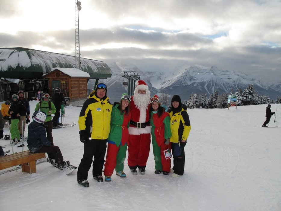 Santa posing with employees and elves at Lake Louise in Alberta, Canada