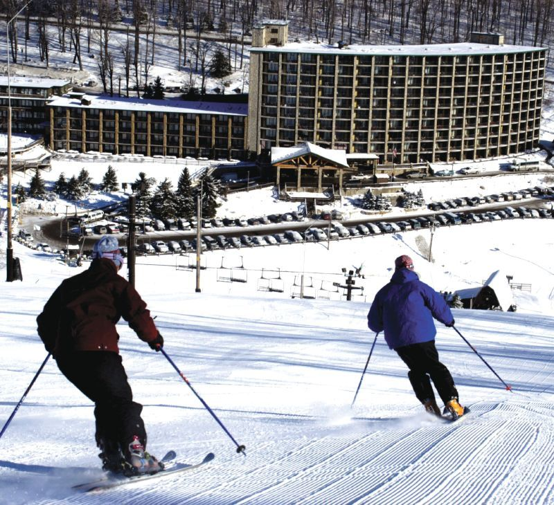 Two skiers make their way toward the lodge in Silver Springs, Pennsylvania