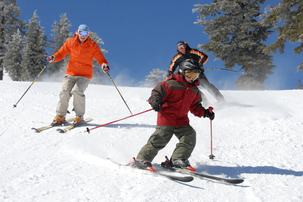 A family skiing down a slope