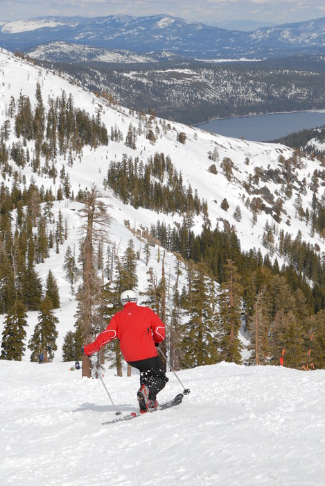 Skier on slopes above Donner Lake