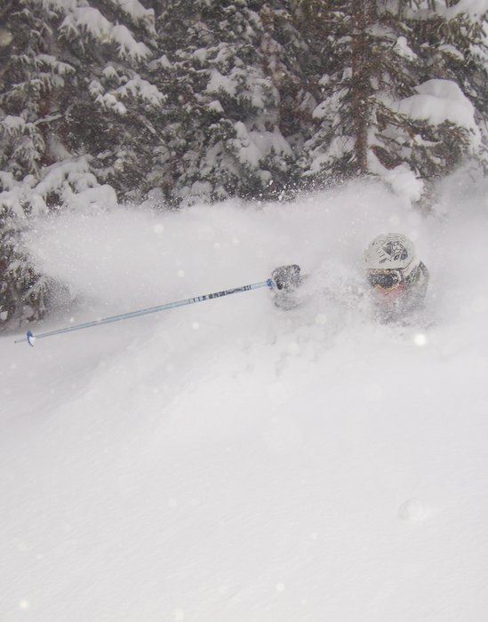 A skier buried in powder at Loveland, CO.