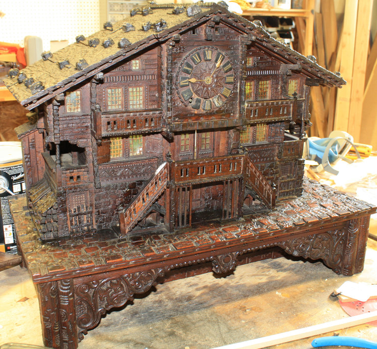 This wood clock with a music box is currently being restored at Ski Country Antiques & Home and is a staff favorite. - ©Ski Country Antiques & Home