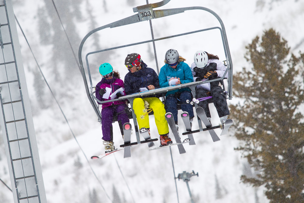 Ski Testers compare notes on the way to their next lap. - ©Cody Downard Photography