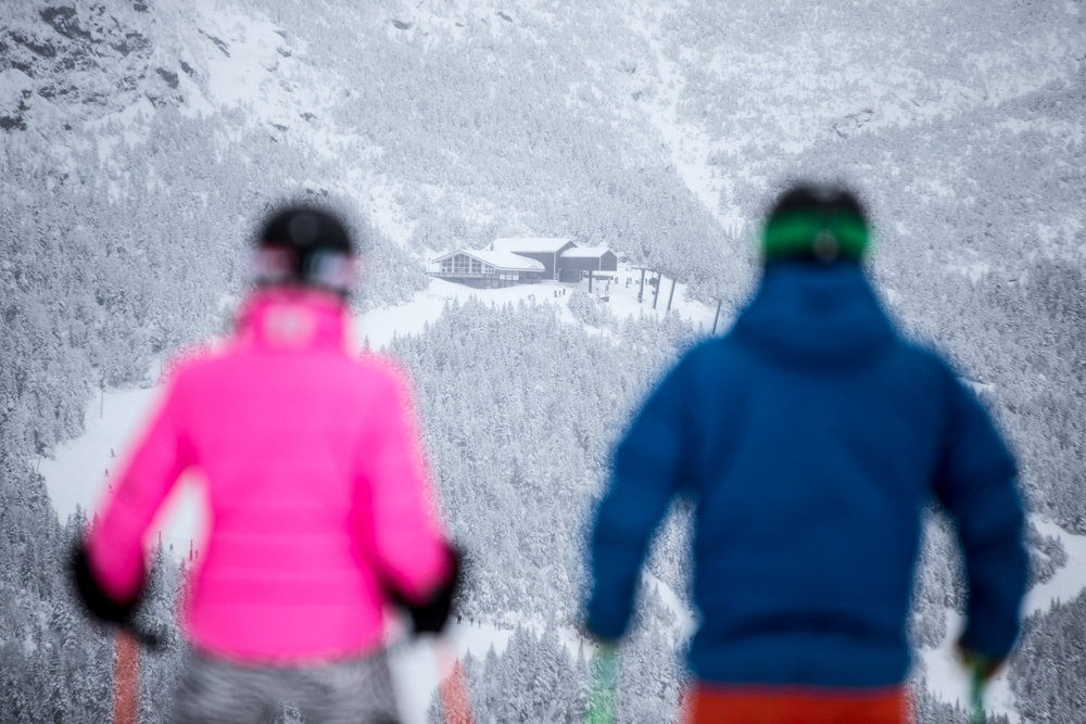 Stowe skiers, Seth and Kristi take in the view of Mt. Mansfield, Vermont's highest.