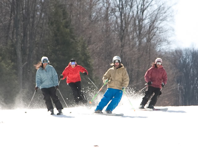 Four skiers at Shawnee Mountain, PA.