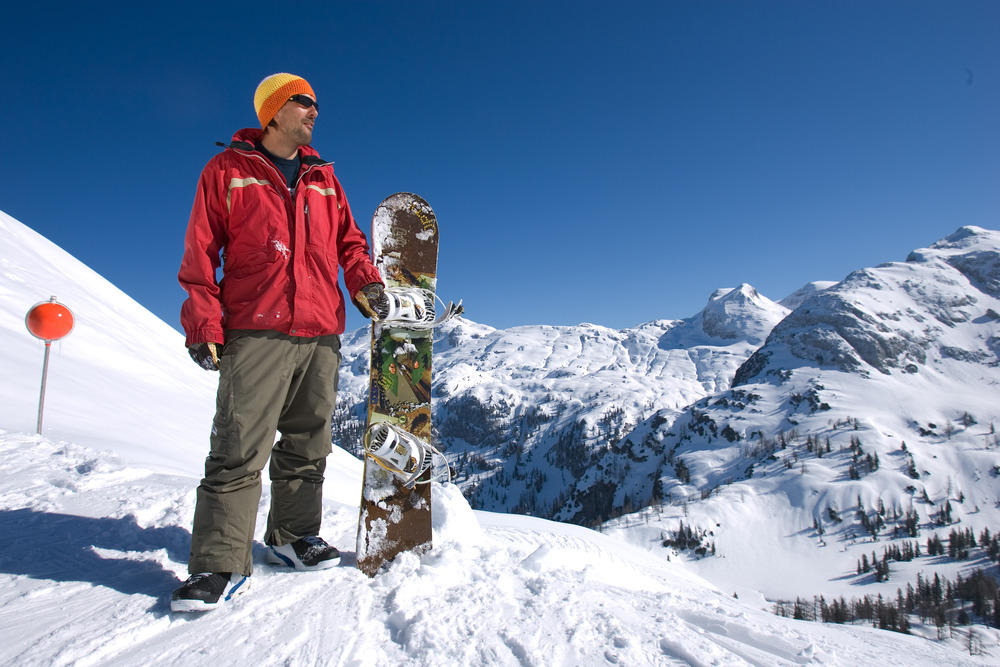A snowboarder poses for a picture at Tauplitz AUT