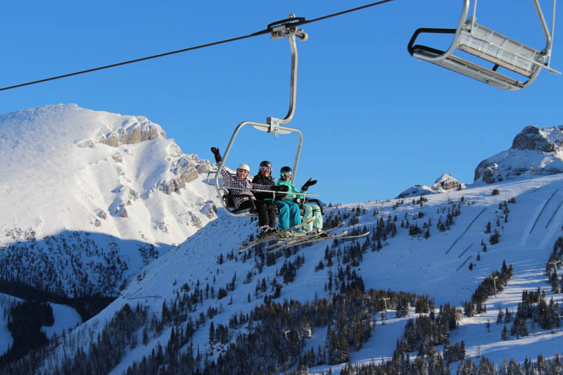 Bluebird skies great opening day skiers and riders at Sunshine Village. - ©Ski Banff-Lake Louise-Sunshine