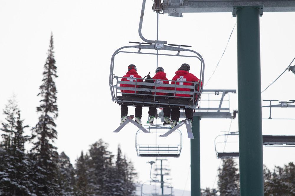 Dave Thibodeau, Lindsey Fell and Joe Calder ride up Sacajawea lift. - ©Cody Downard Photography