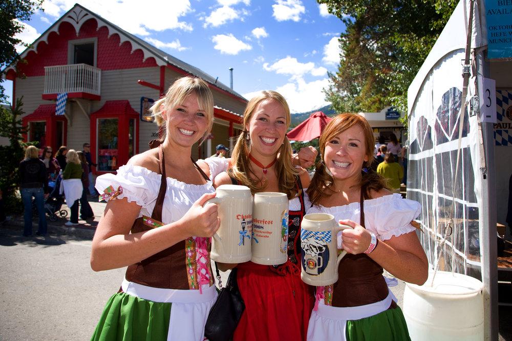 Oktoberfest girls and their steins in Breckenridge. Image by Jeff Scroggins.