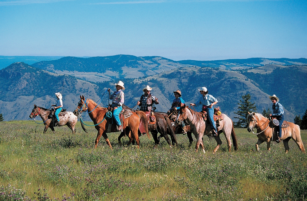 Group of horse riders in Sun Peaks, BC