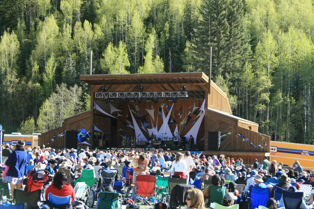 Listeners and the stage of the Telluride Jazz Festival.