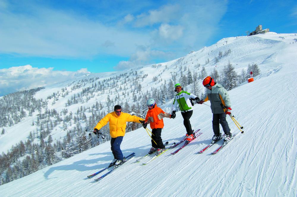 Group of four skiers at Bad Kleinkirchheim