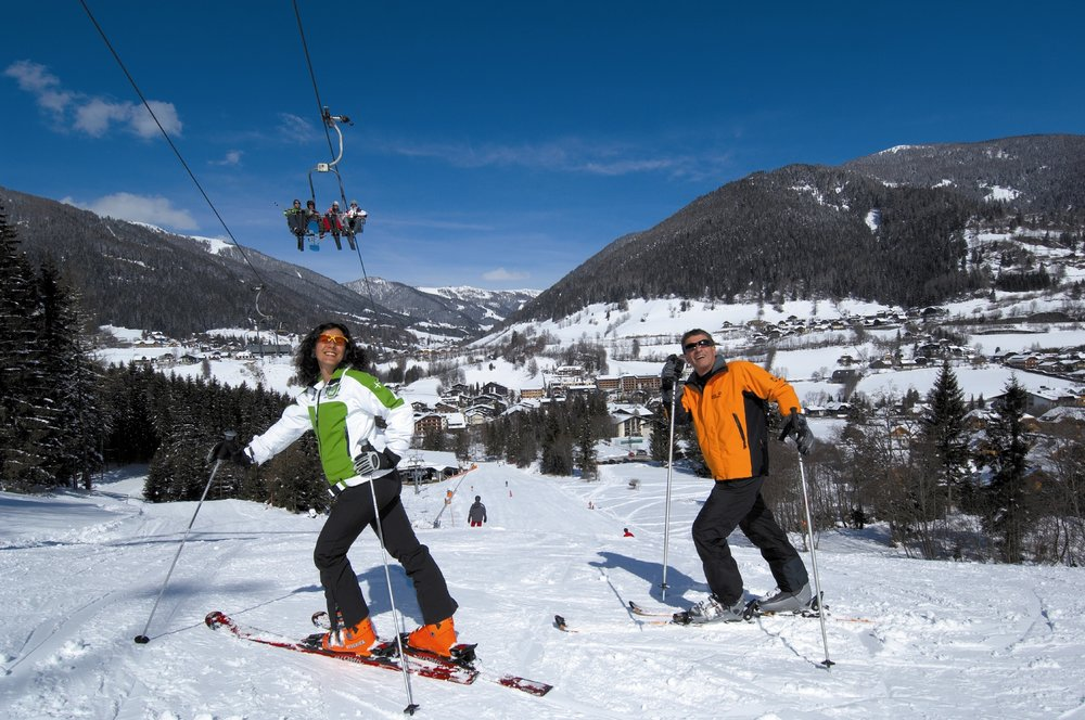 Man and woman skiing under chairlift in bad Kleinkirchheim