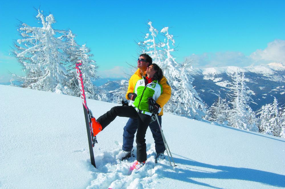 Skiing couple playing at Bad Kleinkirchheim, Austria