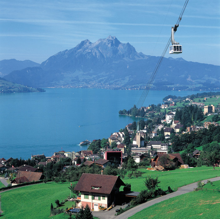 Switzerland. get natural. . Weggis (435 m) on the shores of Lake Lucerne in Canton Lucerne, Central Switzerland. The cable car leads up to Rigi Kaltbad (1438 m), in the background Mt. Pilatus (2120 m).. . Schweiz. ganz natuerlich.. Weggis (435 m) am Vierwaldstaettersee im Kanton Luzern in der Zentra