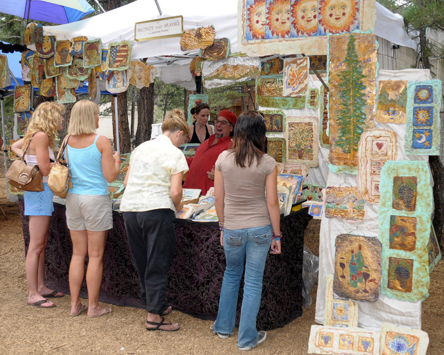 Visitors taking a look around the Mammoth Festival of the Arts.