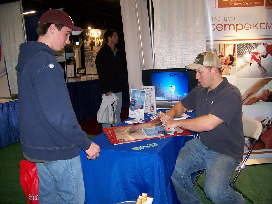 Olympic gold medal snowboarder Ross Powers, representing Okemo, VT, signing a poster for a fan at the 2008 Boston Globe Ski & Snowboard Expo.