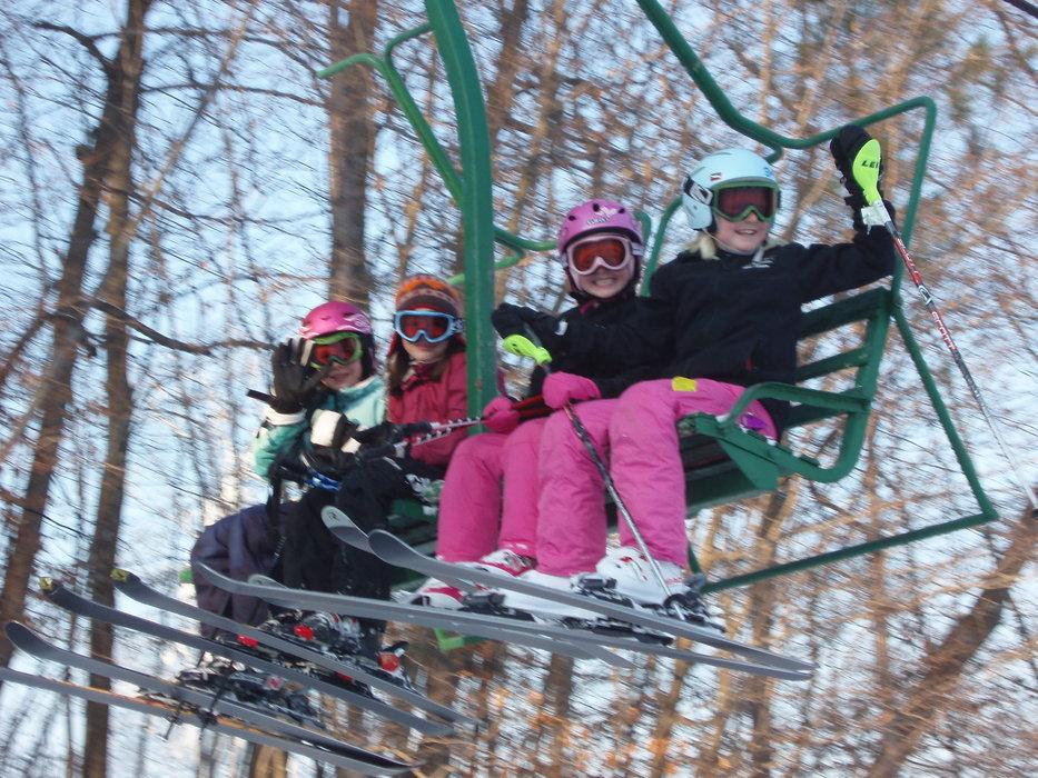 Skiers on lift at Wild Mountain, MN