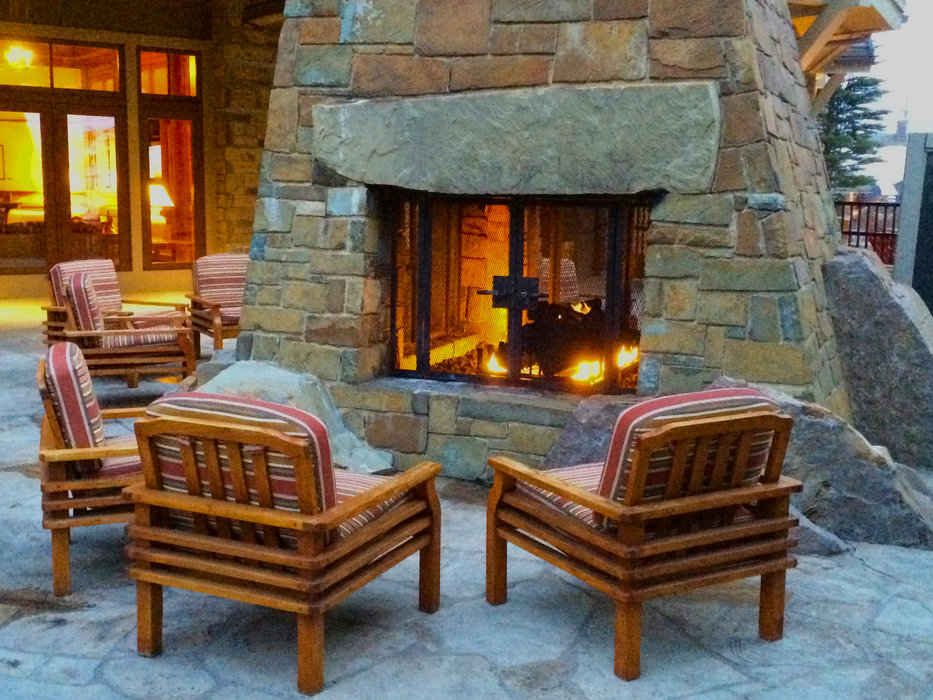 Outdoor firepits and cozy fire nooks line the slope side of Four Seasons. - ©Becky Lomax