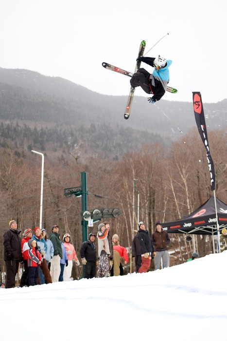 Freeskier jumping in front of crowd in Smugglers' Notch, Vermont.