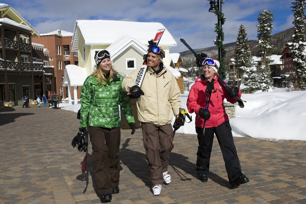 A trio of visitors to the Village at Winter Park, CO.