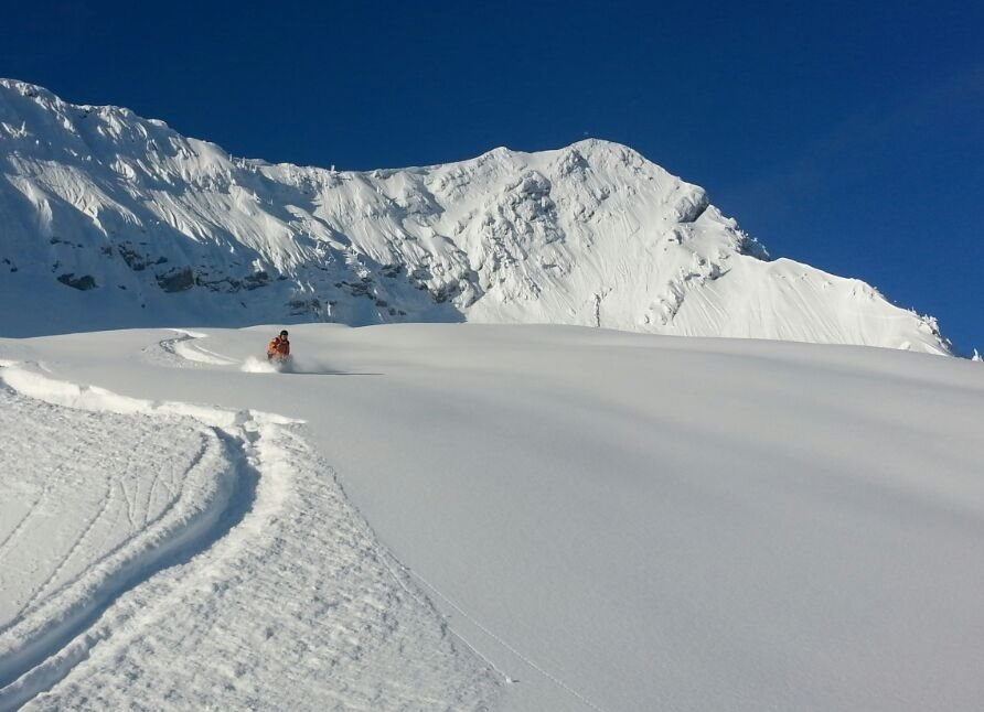 Carving through uncut powder at Fernie. - ©Fernie Ski Patrol