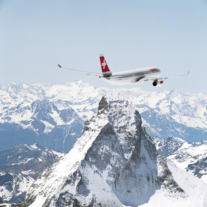 A Swissair jet flying over the Matterhorn.