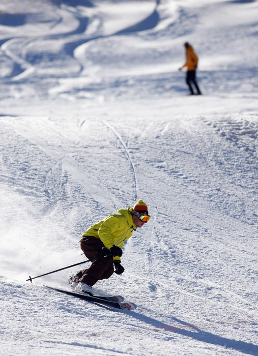In this photo provided by Colorado Ski Country USA, Skiers and snowbaorders enjoy the first day of skiing and riding for the season at the opening of Loveland Ski Area in Georgetown, Colo., Thursday, Oct. 7, 2009. Loveland is the first North American resort to open for the 2009-2010 season.  This is