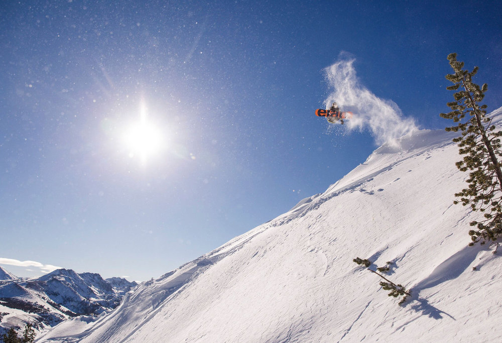 A snowboarder revels in the snow at Mammoth Mountain. - ©Peter Morning/MMSA