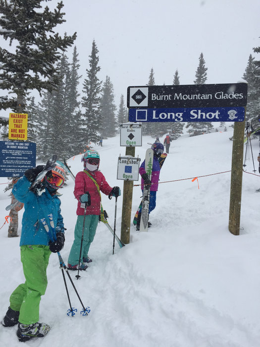 Kids hike up to Long Shot at Snowmass. - ©Krista Crabtree