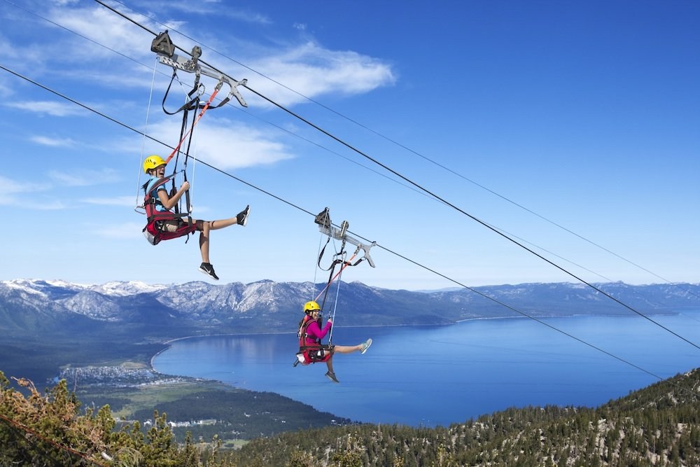 Two brave souls take a spin on Heavenly's Blue Streak Zip Line. - ©Heavenly Mountain Resort