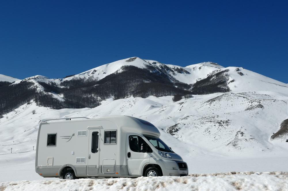 RV camper in snow at Lavarone, Italy.