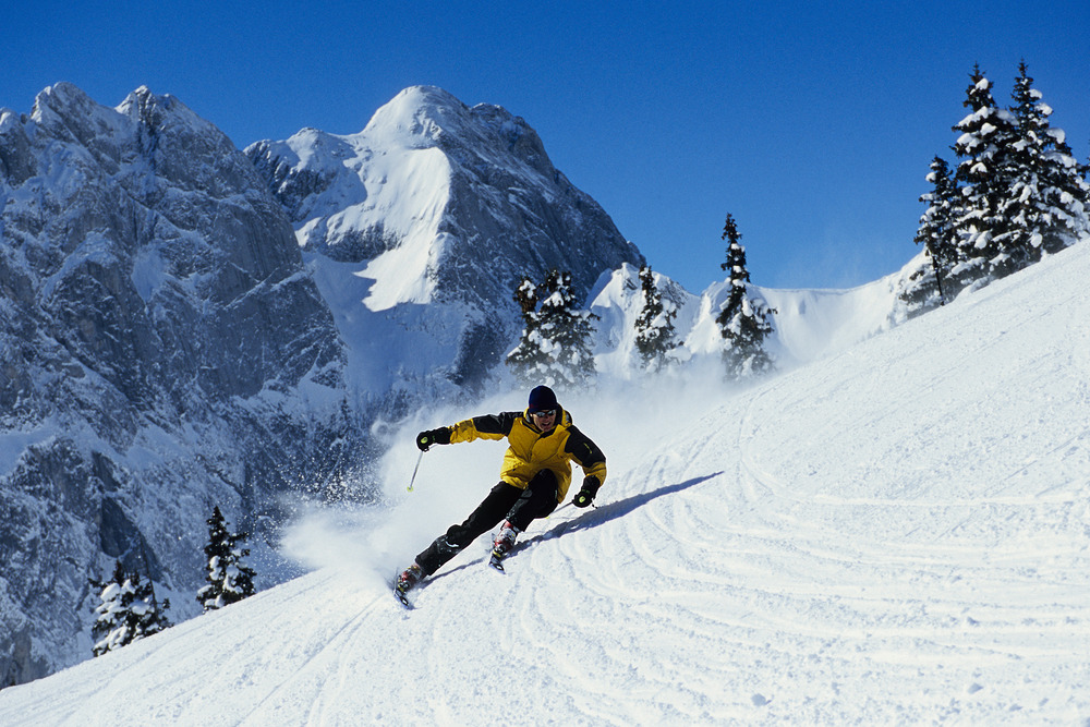 Skier carves a turn at Gstaad, Switzerland.